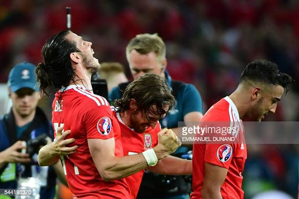 Wales' forward Gareth Bale celebrates with Wales' midfielder Joe Allen and Wales' defender Neil Taylor after the Euro 2016 quarterfinal football...