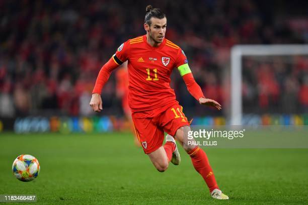 Wales' forward Gareth Bale controls the ball during the Group E Euro 2020 football qualification match between Wales and HUngary at Cardiff City...
