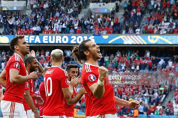 Wales' forward Gareth Bale greets the fans after their victory during the Euro 2016 round of sixteen football match Wales vs Northern Ireland, on...