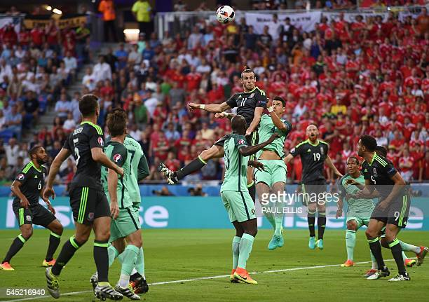 TOPSHOT Wales' forward Gareth Bale heads the ball during the Euro 2016 semifinal football match between Portugal and Wales at the Parc Olympique...