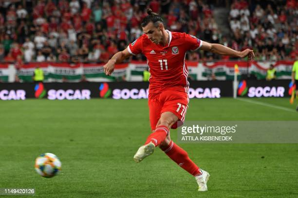 Wales' forward Gareth Bale kicks the ball during during the UEFA Euro 2020 qualifier Group E football match Hungary against Wales on June 11 2019 in...