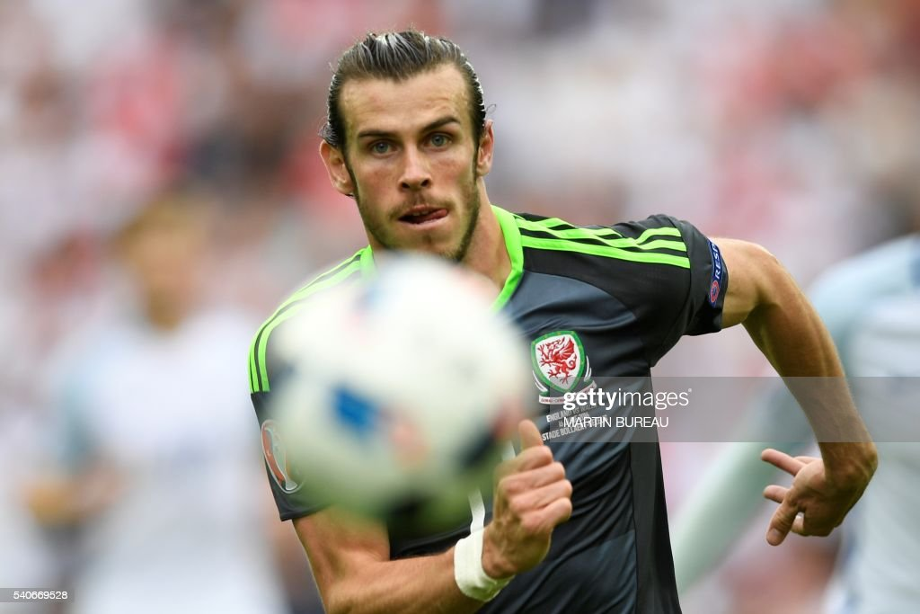 TOPSHOT - Wales' forward Gareth Bale runs for the ball during the Euro 2016 group B football match between England and Wales at the Bollaert-Delelis stadium in Lens on June 16, 2016. /