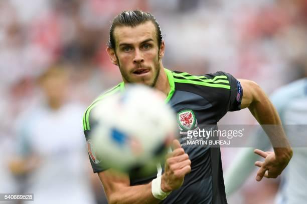 TOPSHOT Wales' forward Gareth Bale runs for the ball during the Euro 2016 group B football match between England and Wales at the BollaertDelelis...