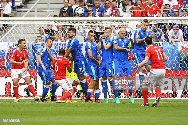 Wales' forward Gareth Bale shoots a free kick and scores the first goal during the Euro 2016 group B football match between Wales and Slovakia at the...