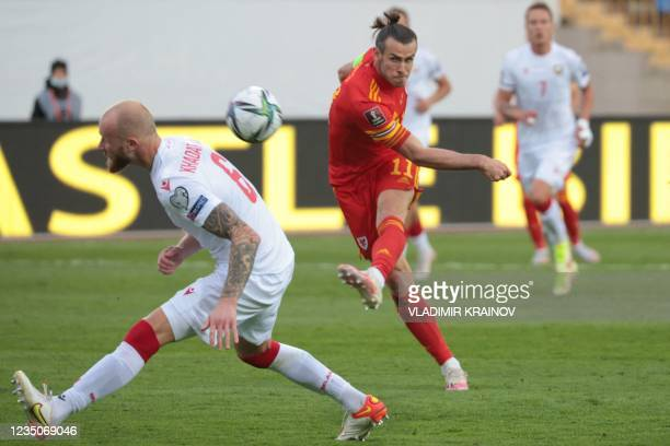 Wales' forward Gareth Bale shoots the ball during the FIFA World Cup Qatar 2022 qualification football match between Belarus and Wales in Kazan on...