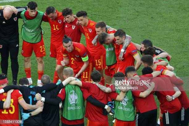 Wales' forward Gareth Bale speaks to teammates after the UEFA EURO 2020 Group A football match between Wales and Switzerland at the Olympic Stadium...