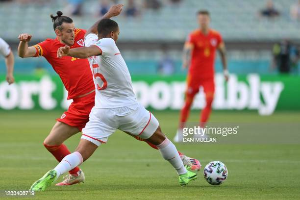 Wales' forward Gareth Bale vies for the ball with Switzerland's defender Manuel Akanji during the UEFA EURO 2020 Group A football match between Wales...