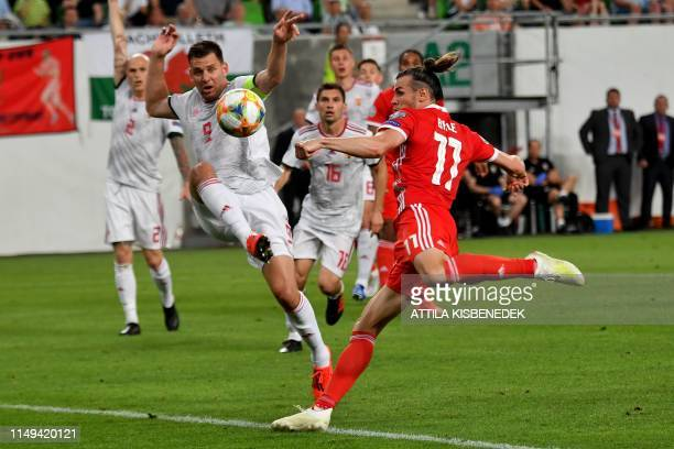 Wales' forward Gareth Bale vies with Hungary's forward Adam Szalai during the UEFA Euro 2020 qualifier Group E football match Hungary against Wales...