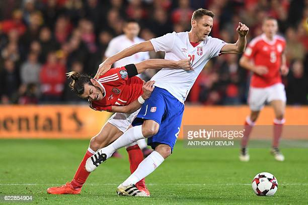 TOPSHOT Wales' forward Gareth Bale vies with Serbia's midfielder Nemanja Matic during the World Cup 2018 qualification match between Wales and Serbia...