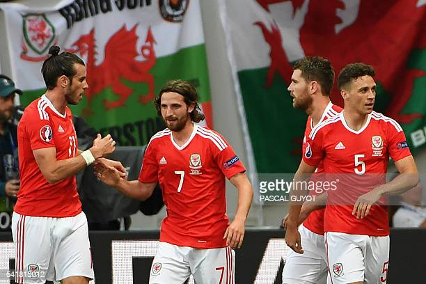 Wales' forward Gareth Bale Wales' midfielder Joe Allen and Wales' defender James Chester celebrate a teams goal during the Euro 2016 group B football...