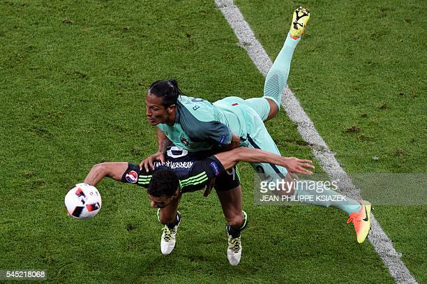 TOPSHOT Wales' forward Hal RobsonKanu and Portugal's defender Bruno Alves clash during the Euro 2016 semifinal football match between Portugal and...