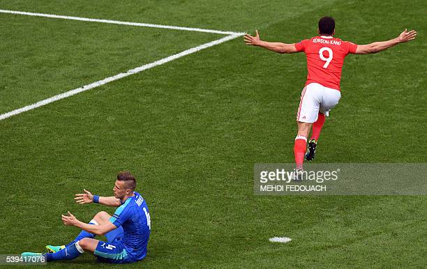 TOPSHOT Wales' forward Hal RobsonKanu celebrates a goal during the Euro 2016 group B football match between Wales and Slovakia at the Stade de...