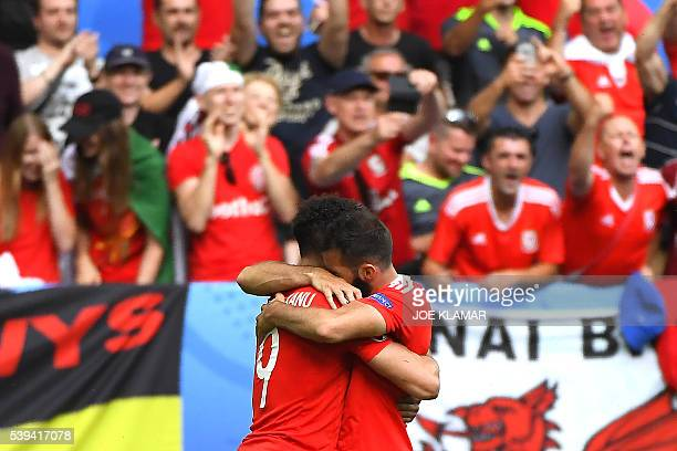 TOPSHOT Wales' forward Hal RobsonKanu celebrates after scoring a goal during the Euro 2016 group B football match between Wales and Slovakia at the...