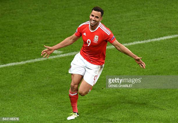 Wales' forward Hal RobsonKanu celebrates after scoring a goal during the Euro 2016 quarterfinal football match between Wales and Belgium at the...