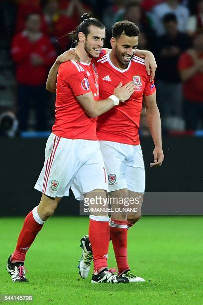 Wales' forward Hal RobsonKanu celebrates after scoring a goal with Wales' forward Gareth Bale during the Euro 2016 quarterfinal football match...