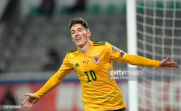 Wale's forward Harry Wilson celebrates after scoring a goal during the FIFA World Cup Qatar 2022 qualification football match between Belgium and...