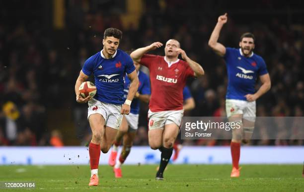 Wales forward Ken Owens reacts as France player Romain Ntamack races away to score his sides third try during the 2020 Guinness Six Nations match...