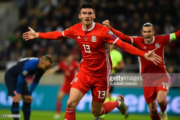 Wales' forward Kiefer Moore celebrates scoring the opening goal during the UEFA Euro 2020 Group E qualification football match Slovakia v Wales in...