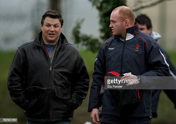 Wales forward Martyn Williams chats to ex player Scott Gibbs on his way to training Wales Rugby Union Training at the Vale of Glamorgan Hotel on...