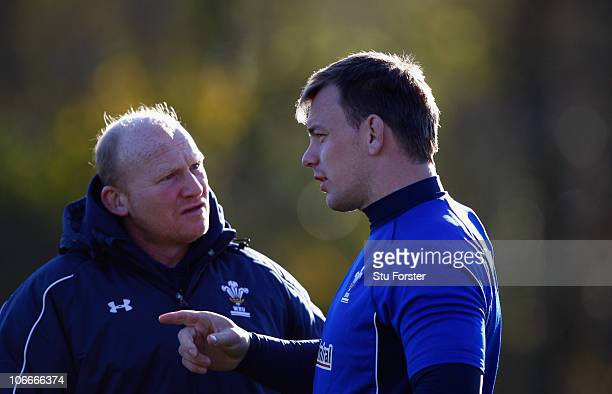 Wales forward Matthew Rees chats with coach Neil Jenkins during Wales Rugby training at Vale of Glamorgan on November 10 2010 in Cardiff Wales