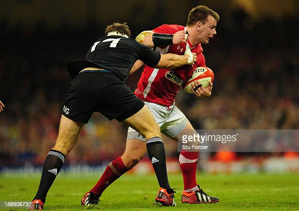 Wales forward Matthew Rees runs into the All Blacks defence during the International Match between Wales and New Zealand at Millennium Stadium on...