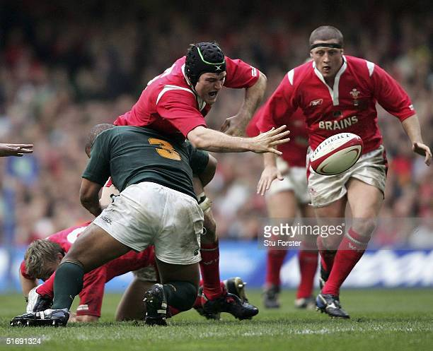 Wales forward Michael Owen is tackled by South Africa number 3 Eddie Andrews during The Lloyds TSB Autumn Series match between Wales and South Africa...