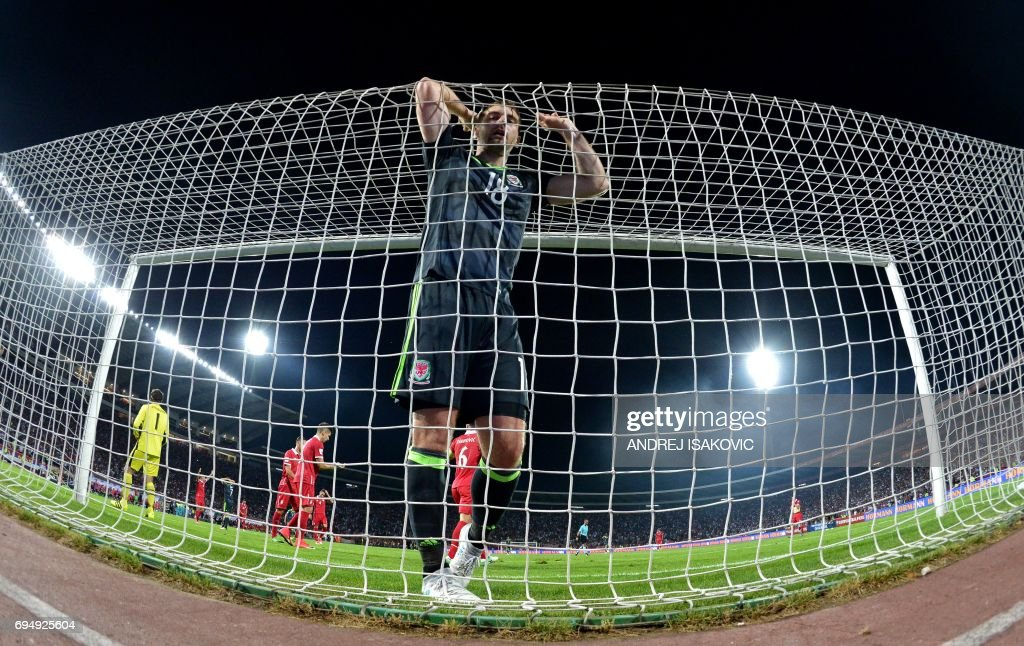 TOPSHOT - Wales' forward Sam Vokes reacts during the FIFA World Cup 2018 qualification football match between Serbia and Wales in Belgrade on on June 11, 2017. /
