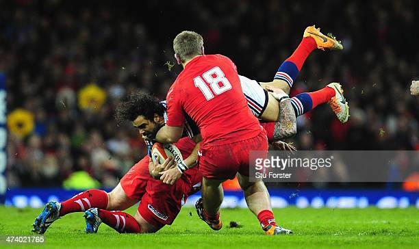 Wales forwards Paul James and Rhodri Jones combine to tackle France wing Yoann Huget during the RBS Six Nations match between Wales and France at...