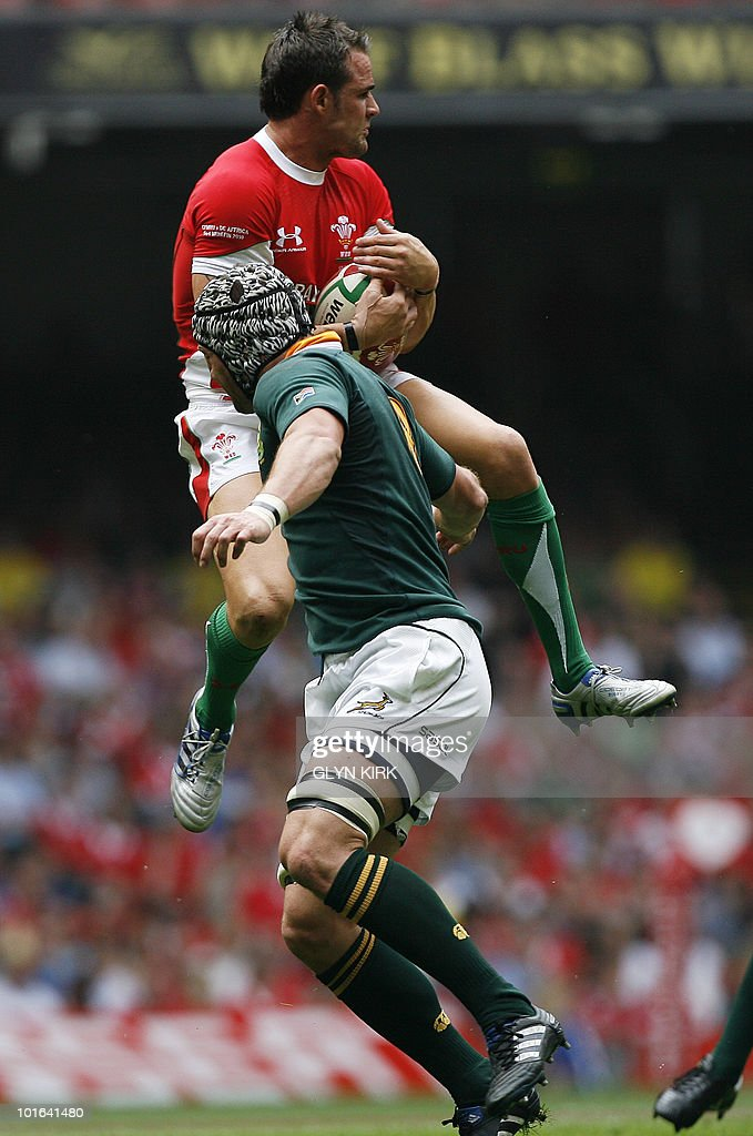 Wales' fullback Lee Byrne (top) is tackled by South Africa's Joe van Niekerk during an international friendly rugby match at the Millennium Stadium in Cardiff, Wales on June 5, 2010.