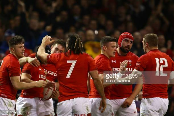 Wales' fullback Leigh Halfpenny celebrates with teammates scoring the team's second try during the Six Nations international rugby union match...