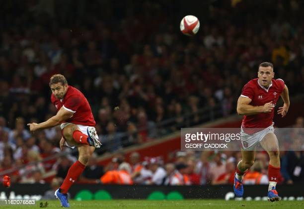 Wales' fullback Leigh Halfpenny kicks the ball to convert a penalty during the international Test rugby union match between Wales and England at...