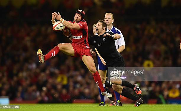 Wales fullback Leigh Halfpenny takes the high ball under pressure from Richie McCaw of New Zealand during the International match between Wales and...