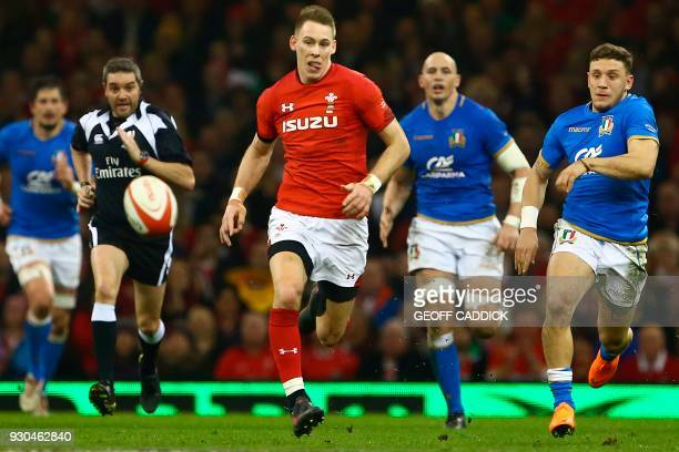 TOPSHOT Wales' fullback Liam Williams chases the ball after kicking it forward during the Six Nations international rugby union match between Wales...