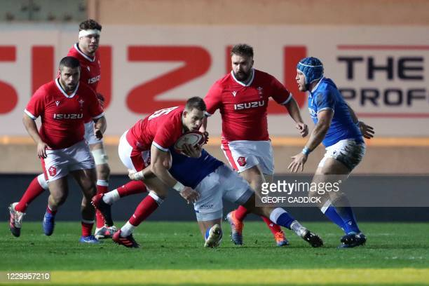 Wales' full-back Liam Williams gets tackled by Italy's prop Danilo Fischetti during the Autumn Nations Cup international rugby union match between...