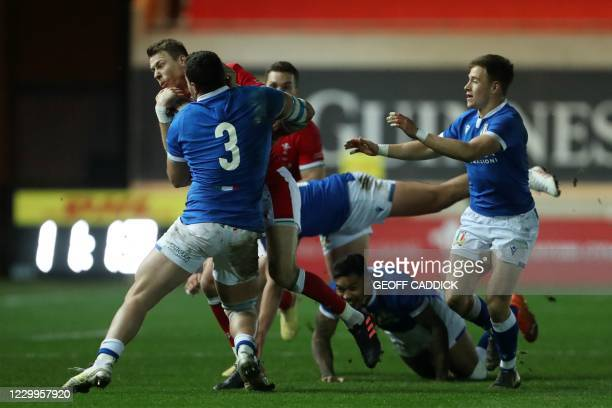 Wales' full-back Liam Williams gets tackled by Italy's prop Giosue Zilocchi during the Autumn Nations Cup international rugby union match between...