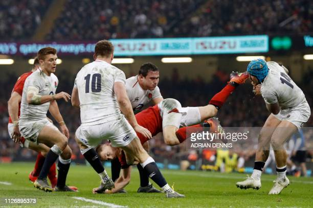 TOPSHOT Wales' fullback Liam Williams is tackled by England's wing Jack Nowell during the Six Nations international rugby union match between Wales...