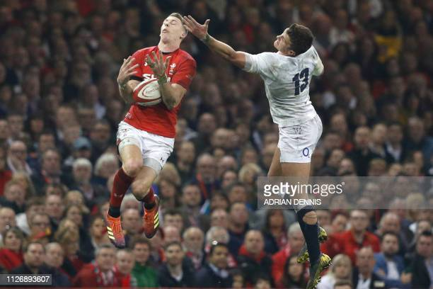 TOPSHOT Wales' fullback Liam Williams jumps for the ball with England's centre Henry Slade during the Six Nations international rugby union match...