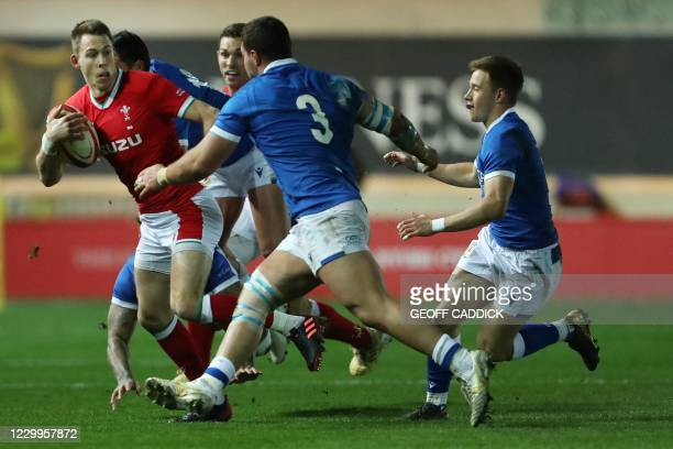 Wales' full-back Liam Williams tries to break through the Italian defence as Italy's prop Giosue Zilocchi closes in during the Autumn Nations Cup...
