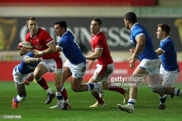 Wales' full-back Liam Williams tries to break through the Italian defence during the Autumn Nations Cup international rugby union match between Wales...