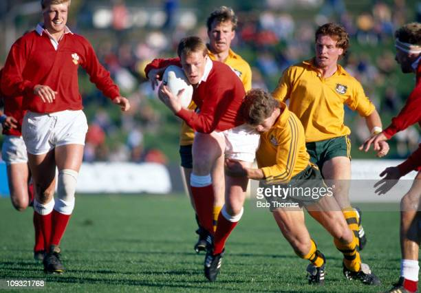Wales fullback Paul Thorburn is tackled by Matt Burke of Australia during the third place playoff of the Rugby Union World Cup held in Rotorua on...
