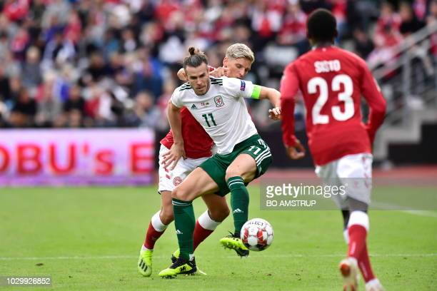 Wales Gareth Bale and Denmarks Simon Kjaer and Pione Sisto vie for the ball during the Nations League football match between Denmark and Wales on...