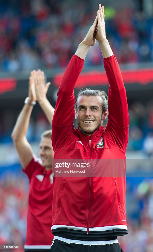 Wales' Gareth Bale applauds the crowd during a ceremony at the Cardiff City Stadium on July 8, 2016 in Cardiff, Wales. The players toured the streets of Cardiff in an open top bus before arriving at the Cardiff City Stadium for an after party for which 33,000 tickets were sold. Wales historic run in Euro 2016 saw them reach the semi-finals, before being knocked out 2-0 by Portugal at Stade de Lyon in France.