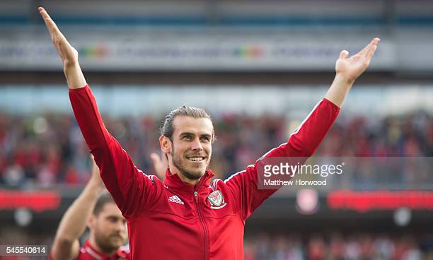 Wales' Gareth Bale applauds the crowd during a ceremony at the Cardiff City Stadium on July 8 2016 in Cardiff Wales The players toured the streets of...