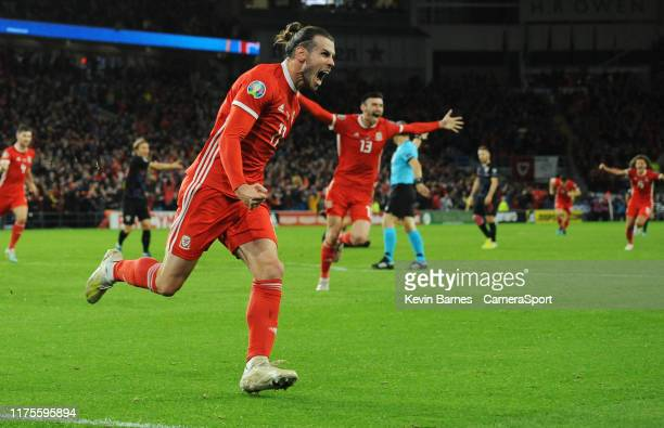 Wales Gareth Bale celebrates scoring his side's first goal during the UEFA Euro 2020 qualifier between Wales and Croatia at Cardiff City Stadium on...
