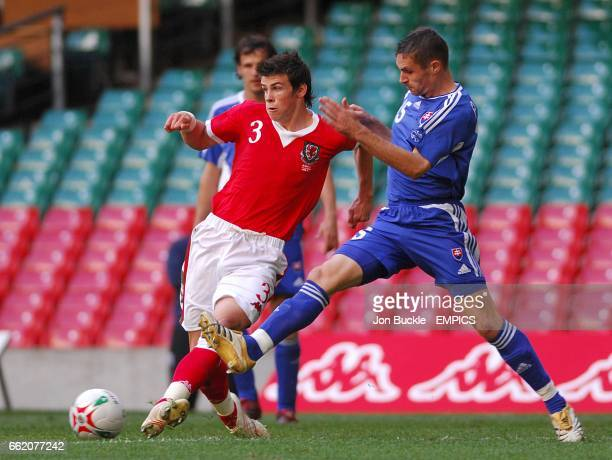 Wales' Gareth Bale is challenged by Slovakia's Sganislav Varga