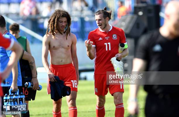 Wales Gareth Bale talks with Ethan Ampadu after the Euro 2020 qualification football match between Croatia and Wales at Gradski vrt stadium in Osijek...