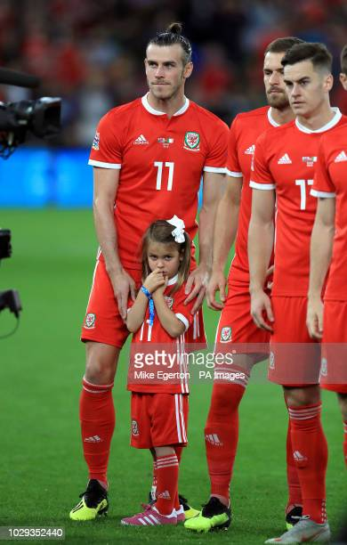 Wales' Gareth Bale with daughter Alba Violet Bale as the players line up before the game