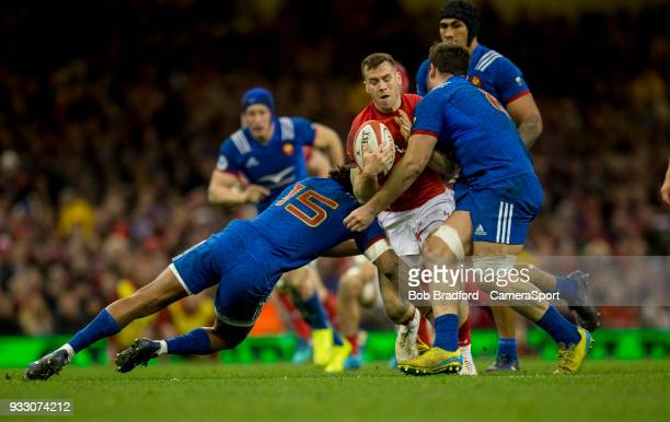Wales' Gareth Davies is tackled by France's Benjamin Fall during the NatWest Six Nations Championship match between Wales and France at Principality...