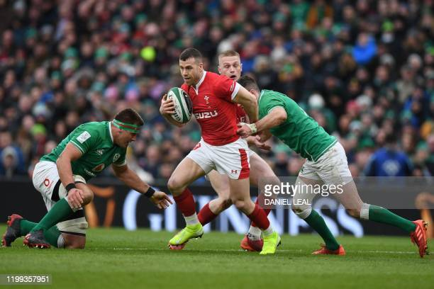 Wales' Gareth Davies is tackled during the Six Nations international rugby union match between Ireland and Wales at the Aviva Stadium in Dublin on...