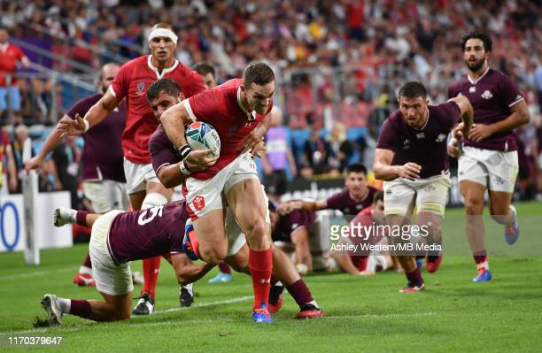 Wales' George North evades the tackle of Georgia's Soso Matiashvili to score his sides sixth try during the Rugby World Cup 2019 Group D game between...